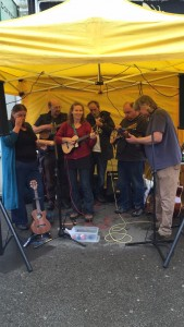 playing in the rain at Woodgrange Market 26.7.15